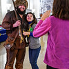 Mountaineer Mascot, Timmy Eades, smiling for a photo with a prospective student at WVU Day at the Legislature in Charleston, WV on Jan. 21, 2020. Photo: Kallie Nealis.