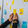 Prospective students place sticky notes with what they'd like to be when they grow up while at WVU Day at the Legislature in Charleston, West Virginia on Jan. 22, 2020. Photo by Kallie Nealis.