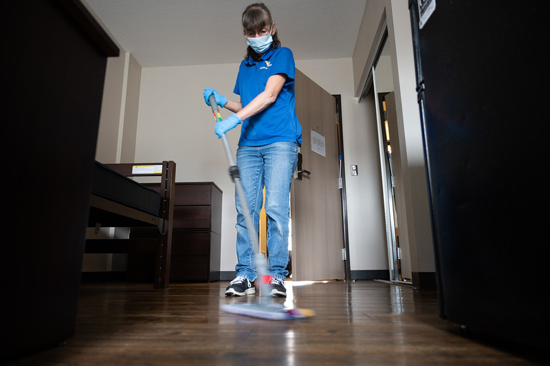 A WVU facilities employee disinfects a floor in Oakland Hall during the Covid-19 Coronavirus global pandemic. (Photo Chris Young).