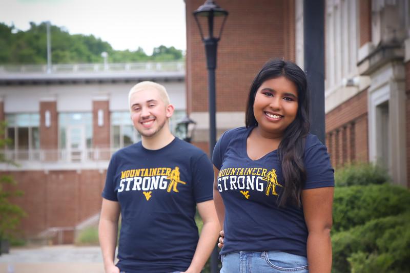 Students model fan shirts at Oglebay Plaza on a summer day at West Virginia Univesity, June 20, 2020. Photo: Adrienne Kemp-Rye