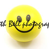 Yellow Smiley Face Stress Ball photographed on a white background