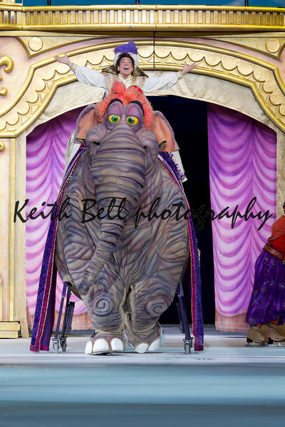 GREEN BAY, WI - MARCH 10: Aladdin with hands out riding an elephant on skates from Aladdin at the Disney on Ice Treasure Trove show at the Resch Center on March 10, 2012 in Green Bay, Wisconsin.