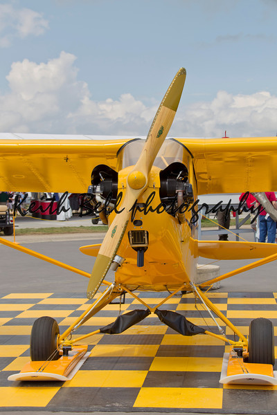 OSHKOSH, WI - JULY 27: Front View of a Yellow Piper Cub 75th Anniversary airplane on display at the 2012 AirVenture at EAA on July 27, 2012 in Oshkosh, Wisconsin.
