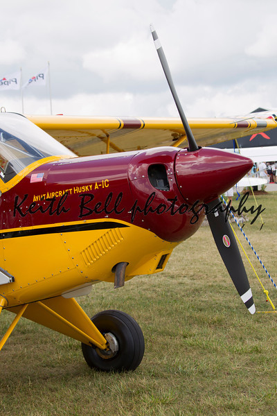 OSHKOSH, WI - JULY 27: The front view of a Maroon & Yellow Aviat Aircraft Husky A-1C on display at the 2012 AirVenture at EAA on July 27, 2012 in Oshkosh, Wisconsin.