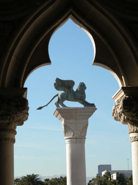 Venetian arch and statue