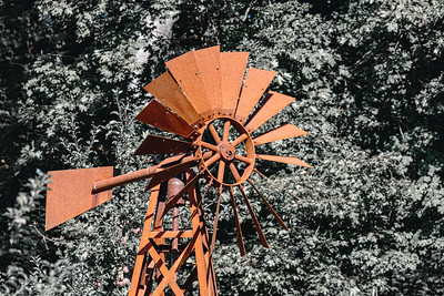 Wind powered water pump with rusty pipes
