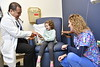WVU Medicine's Dr. Tombac WVU Childrens Hospital works with patients and famlies at the infusion center. February 20, 2020. (WVU Photo/Greg Ellis)