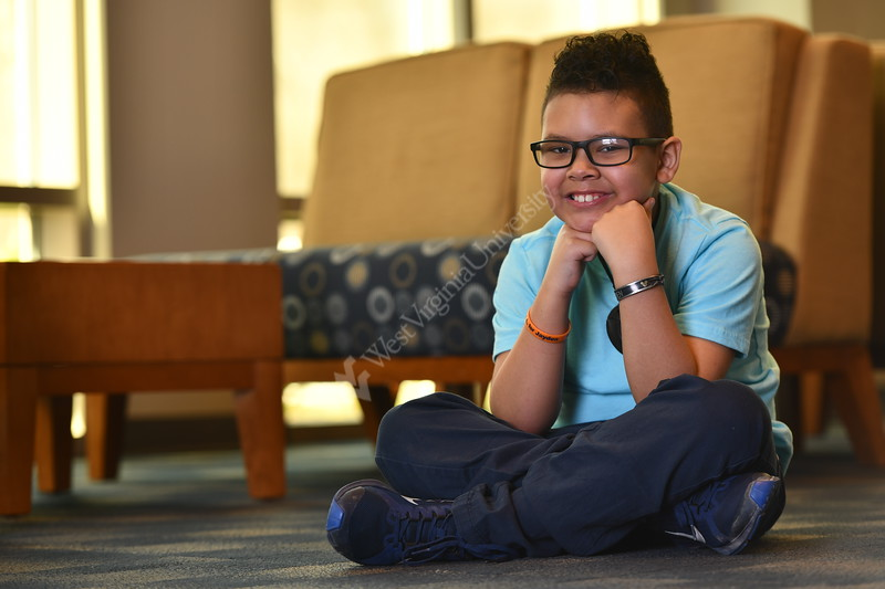WVU Medicine Patient, Jayden Poyser poses for pictures at the WVU Visitor Center March 13, 2020. (WVU Photo/Greg Ellis)