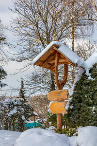 beautiful signpost in winter garden