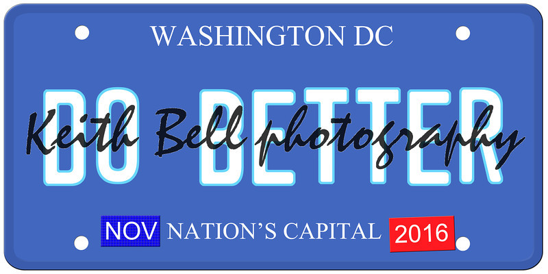 An imitation Washington DC license plate with November 2016 stickers and DO BETTER written on it making a great political concept.  Words on the bottom Nations Capital.
