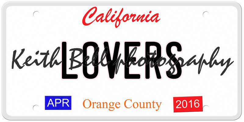An imitation California license plate with April 2016 stickers and LOVERS written on it making a concept.  Words on the bottom Orange County.