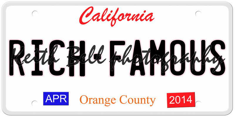 An imitation California license plate with April 2014 stickers and RICH FAMOUS written on it making a great concept.  Words on the bottom Orange County.