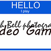 Hello I Play Video Games on a blue name tag sticker