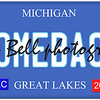 An imitation Michigan license plate with December 2014 stickers and COMEBACK written on it making a great Detroit or Michigan auto concept.  Words on the bottom Great Lakes.