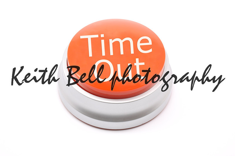 Large, red time out push button photographed on a white background