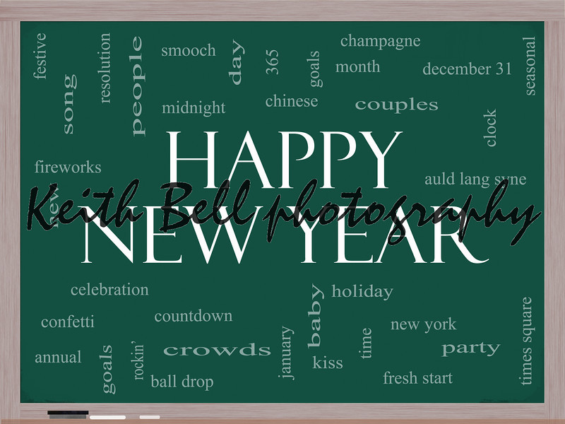 Happy New Year Word Cloud Concept on a Blackboard with great terms such as celebration, holiday, countdown, kiss and more.