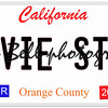 An imitation California license plate with April 2014 stickers and MOVIE STAR written on it making a great concept.  Words on the bottom Orange County.