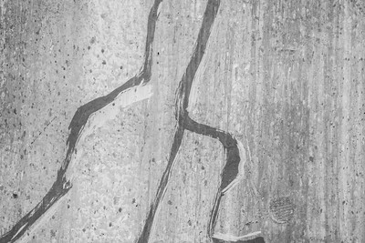 Cracks in Cement Grey Wall