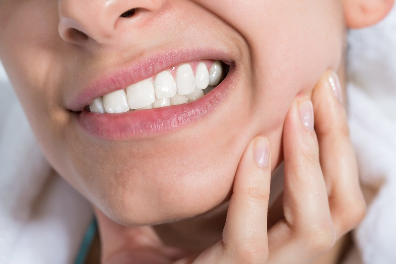 Why Flossing Could Be Ruining Your Gums & The Profound Connection Between Your Mouth, Your Mitochondria and Your Blood Pressure with Dr. Al Danenberg - AdobeStock 101350708 woman teeth discomfort L
