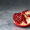 broken pomegranate on scratched metall