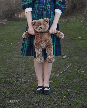 Lonely School Child Holding Teddy Bear