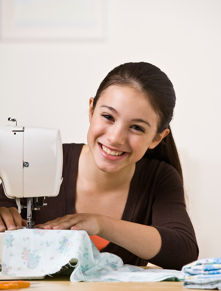 Smiling Teen Sewing