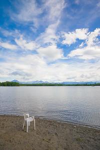 Lawn Chair on Lake Shore