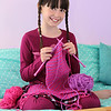 Young girl knitting