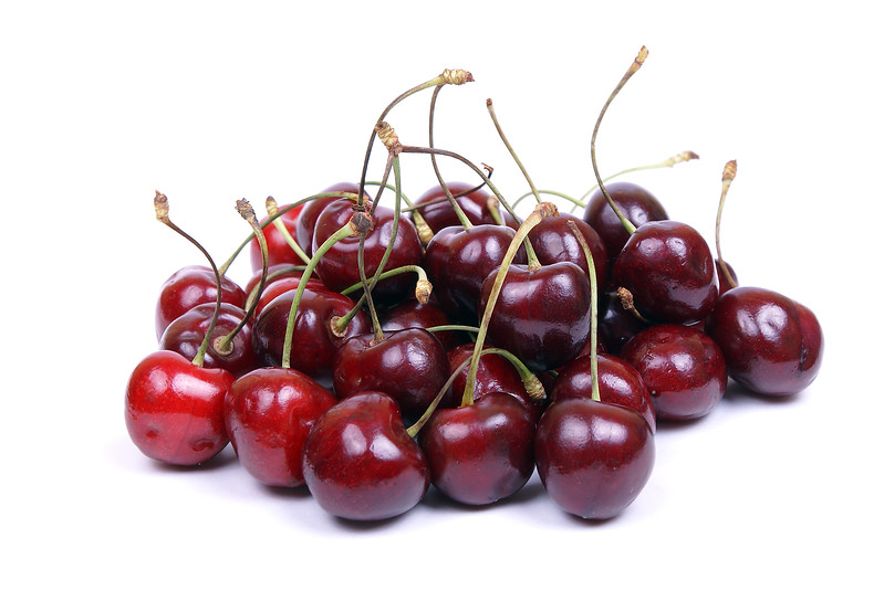 isolated sweet red cherry