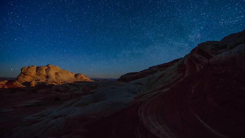 stock-timelapse-stars-moonrise-alien-landscape