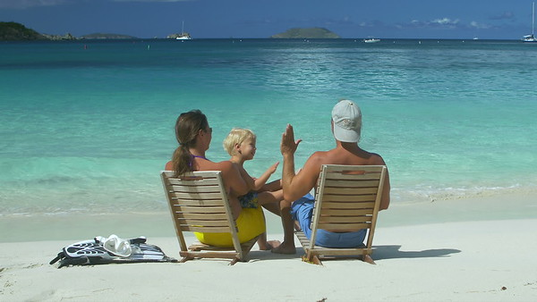 0011 family relaxing at the beach in chairs in the Caribbean