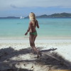 0052 slow motion video of women walking on a tropical beach with lounge chairs, smuggler's cove, tortola