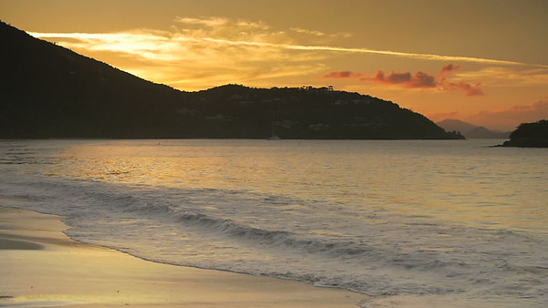 0003 slow motion shoreline with pelican sunset, st john, virgin islands