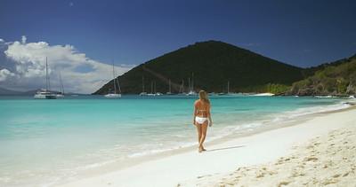 0016 bikini woman walking down a tropical beach, White Bay, Jost Van Dyke