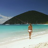 0016 bikini woman walking down a tropical beach, White Bay, Jost Van Dyke