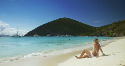 0017 bikini woman walking down a tropical beach, White Bay, Jost Van Dyke