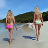 0057 slow motion video of women walking on a tropical beach, smuggler's cove, tortola