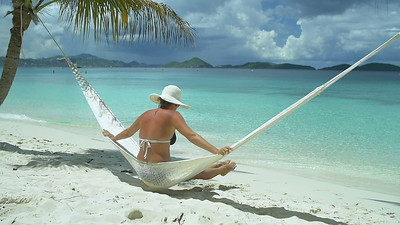 0022 slow motion video of a woman relaxing in hammock on perfect tropical beach