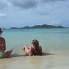 0048 slow motion video women sitting on tropical beach, smuggler's cove, tortola