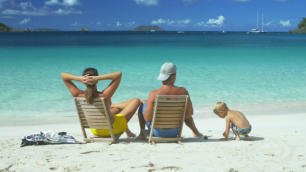 0012 family relaxing at the beach in chairs in the Caribbean