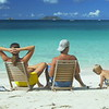 family relaxing at the beach in chairs in the Caribbean