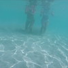 0041 women swimming underwater in turquoise water