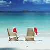 Christmas teak chairs on a tropical beach in the Caribbean