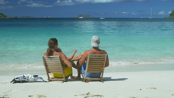 0010 family relaxing at the beach in chairs in the Caribbean