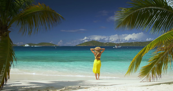 0004 woman standing on tropical beach in the caribbean, St John