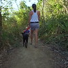 Mother, child and dog hiking on a trail at sunset in the Virgin Islands
