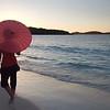 0090 woman walking with umbrella on tropical beach, St John