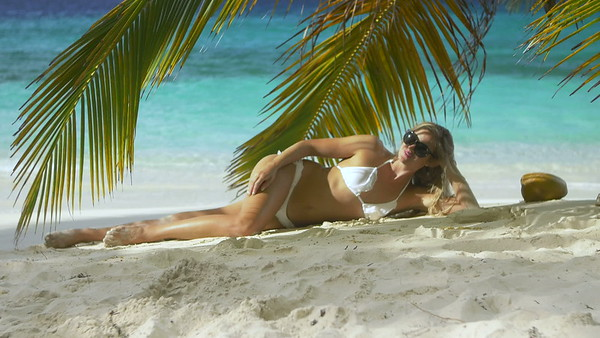 0014 bikini woman sunbathing on tropical beach in the Caribbean
