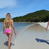 0058 slow motion video of women walking on a tropical beach, smuggler's cove, tortola
