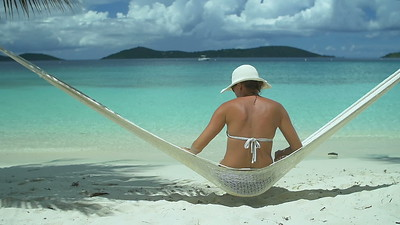 0021 slow motion video of a woman relaxing in hammock on perfect tropical beach